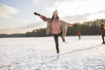 Woman dancing with ice skates — Stock Photo