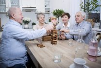 Senior couples having games evening — Stock Photo