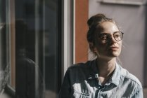 Woman with glasses thinking — Stock Photo
