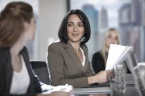 Women talking in boardroom — Stock Photo