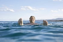 Man floating in sea — Stock Photo
