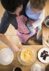 Father and baby boy baking a cake in kitchen — Stock Photo