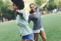 Two best friends having fun together in the park at evening — Stock Photo