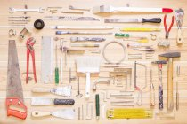Various tools arranged on wooden surface — Stock Photo