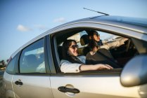 Two young women traveling in a car in Spain, Andalusia, Vejer de la Frontera — Stock Photo