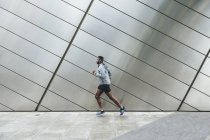 Young Man running in urban area — Stock Photo