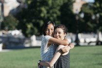 Portrait of two best friends hugging in the park — Stock Photo