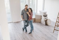 Couple moving house, woman holding keys of new home — Stock Photo