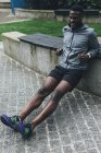 Young Man doing push ups before running — Stock Photo