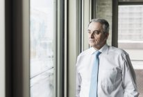 Manager looking out of window — Stock Photo