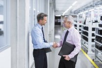 Managers shaking hands — Stock Photo