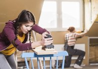 Portrait of young couple renovating attic — Stock Photo