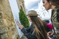 Traveling Woman taking a photo with a smartphone — Stock Photo