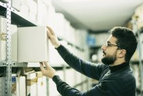 Man working in an archive — Stock Photo