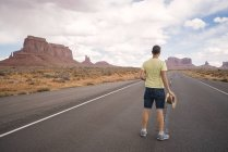 USA, Utah, Monument Valley, man standing on road — Stock Photo