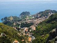 Italy, Sicily, Castelmola, Taormina town and bay of Giardini Naxos — Stock Photo