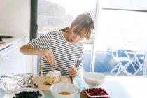 Woman preparing vegan cake — Stock Photo