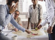 Cropped portrait of business colleagues discussing project — Stock Photo