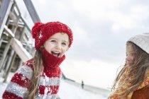 Happy little sisters having fun in winter — Stock Photo