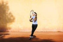 Portrait of teenage girl playing tennis — Stock Photo
