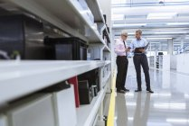 Managers discussing on shop floor — Stock Photo