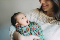 Mother holding her newborn baby girl — Stock Photo