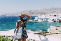Mykonos City, Greece, Woman looking to Little Venice from the popular Windmills — Stock Photo