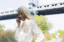 Portrait of senior woman using smartphone — Stock Photo
