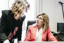 Two businesswomen working together in office — Stock Photo