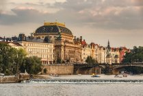 Czechia, Prague, exterior of National theatre with Vltava river — Stock Photo