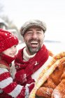 Father and daughters having fun in the snow — Stock Photo
