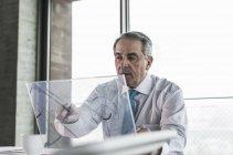 Manager using futuristic computer — Stock Photo