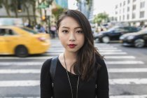 Portrait of young Asian woman at street — Stock Photo