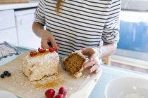Woman cutting vegan cake — Stock Photo