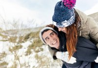 Asturias, Spain, young couple having fun in the snow — Stock Photo