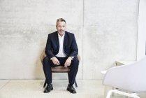 Businessman sitting in armchair — Stock Photo