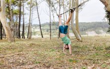 Athlete man doing suspension traning outdoors — Stock Photo