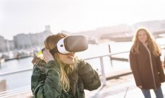 Gijn, Asturias, Spain, young women using VR glasses outdoors — Stock Photo