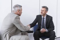 Business partners shaking hands — Stock Photo