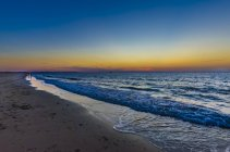 View of empty sand beach at sunset,zeeland — Stock Photo