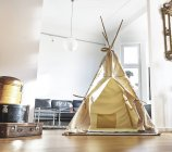 Teepee on floor in modern living room — Stock Photo
