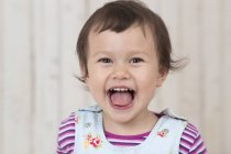 Portrait of laughing little girl looking at camera — Stock Photo