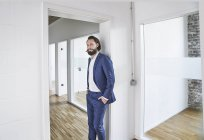 Businessman standing in empty office — Stock Photo