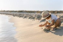 Little girl playing on the beach, Son Bou beach, Balearic Islands, Spain — Stock Photo