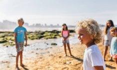 Group of kids playing on the beach, Gijn, Asturias, Spain — Stock Photo