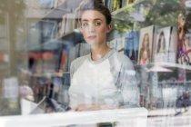 Woman reading book in bookshop — Stock Photo