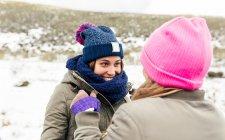 Asturias, Spain, two friends having fun in the snow — Stock Photo