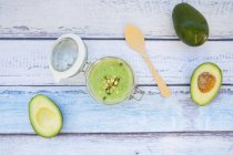 Avocado cucumber soup garnished with sprouts — Stock Photo
