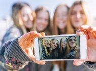 Four young women taking a selfie — Stock Photo