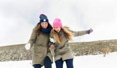 Asturias, Spain, two friends having fun in the snow — Stock Photo